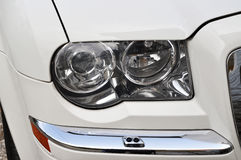 Head lamp of white car. Close-up of a new modern car head Stock Images