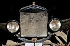 Head lamps, grill,  and radiator of a very old auto Stock Photo