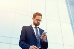 Head of a large company has received bad news on cell phone Royalty Free Stock Photography