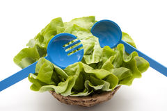Head lettuce with salad servers Stock Photo