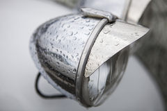 Head light. Classic car headlight under rain Royalty Free Stock Image