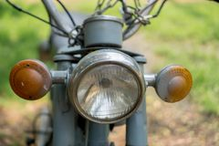Head light of circa mid 1960 classic and vintage Yamaha motorcycle. CHONBURI, THAILAND - MARCH 14, 2018 : Head light of circa mid 1960 classic and vintage Yamaha royalty free stock photo