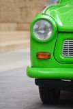 Head light of a East-German plastic vintage car. Green Trabant Stock Image