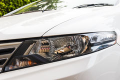 Head light of white car. Stock Photography