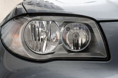 Head lights. Of a sport grey car royalty free stock images