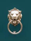 Head of lion doorknocker. Doorknocker with Lion on a green background Royalty Free Stock Image
