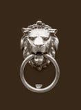 Head of lion doorknocker. Doorknocker with head of lion close up Royalty Free Stock Images