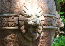 The head of a lion hewn out Kolomna in the green park Stock Image