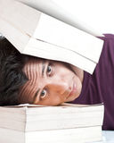 Head Locked Between the Books Stock Images