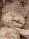 Head of the Lying Buddha. The Lying Buddha Statue in Anuradhapura Royalty Free Stock Photography
