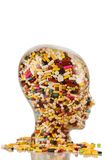 Head made of glass with tablets Royalty Free Stock Photo
