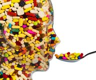 Head made of glass with tablets. A head made of glass filled with many tablets. photo icon for drugs, abuse and addiction tablets Stock Images