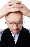 head man för confused händer Royaltyfri Bild