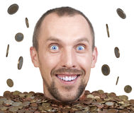 Head of man in a heap of euro coins Stock Photo