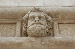 Head of a man - sculpture of the Sibenik Cathedral. Renaissance stone portrait of an anonymous man - Saint James Cathedral, Sibenik, Croatia Royalty Free Stock Photography