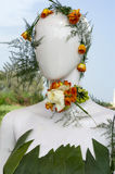Head of mannequin covered with flower crown Royalty Free Stock Image