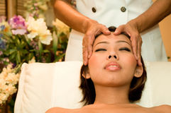 Head Massage. A young Asian woman has a head massage Royalty Free Stock Images