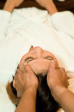 Head Massage. A young Asian woman having her head massaged by a therapist Royalty Free Stock Images