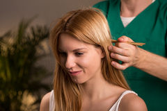 Head massage with bamboo sticks Royalty Free Stock Photos
