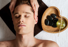 Head massage on man in the spa Stock Photo