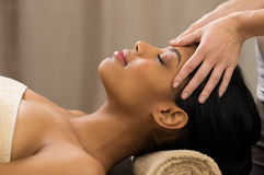 Head massage at spa. Closeup of young women receiving professional head massage at spa Royalty Free Stock Image