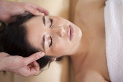 Head massage at a spa Royalty Free Stock Image