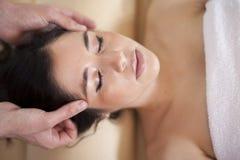 Head massage at a spa Royalty Free Stock Image