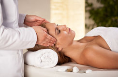 Head massage in spa room Stock Images