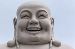 Head of Massive White Buddha isolated from decor. Royalty Free Stock Photography