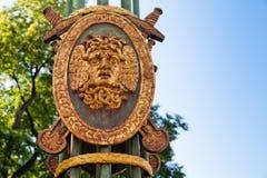 Head of Medusa Gorgon. On the shield. Decorative lantern of the Panteleymonovsky Bridge, St.Petersburg, Russia royalty free stock photography