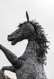 Head of metal sculpture horse and blur background. Royalty Free Stock Photography