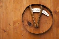 Head meter hatmaker tools craft on wooden texture Stock Photography