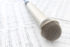 Head microphone. Silver head microphone with notes stock image