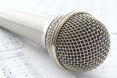 Head microphone. Silver head microphone with notes royalty free stock images