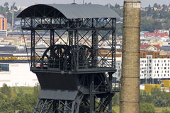 Head of the mining tower and a chimney with Ostrava center in the background Stock Photo