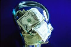 Head with Money inside Royalty Free Stock Photos