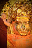 The head of monks performs a ritual, daily washing the face of Buddha Royalty Free Stock Photos