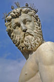 The head of Neptune against a blue sky Royalty Free Stock Photo