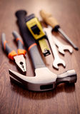 Head Of A Claw Hammer On A Table With Other Tools Stock Photo