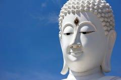 Head Of White Buddha Against Blue Sky. Stock Photo