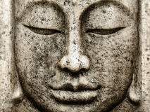 Head of an old buddha statue Stock Photo