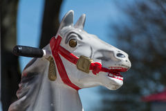 Head of an old carousel horse or coin operated rocking horse Royalty Free Stock Photo