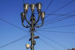 Head of an old fashioned victorian style lampost against a blue sky.  Stock Photo
