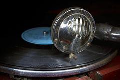 Head with an old gramophone needle on the vinyl disc Stock Photos