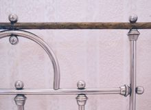 Head of old iron bed close-up stock photo