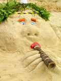 Head out of the sand on the beach made Stock Image