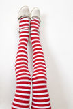 Head over heels. female legs in stripy stockings Stock Photography