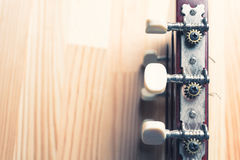 Head and pegs of a guitar on a background. Royalty Free Stock Image