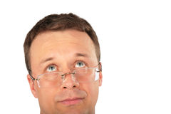 Head of pensive man in glasses look up royalty free stock image