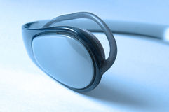 Head phones. Close up behind the ear head phones in blue Royalty Free Stock Photo
